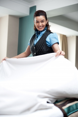 A maid cleaning the room