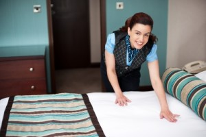 Cleaning the bedroom by maid services